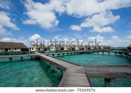 water bungalows in maldives resort #79269076
