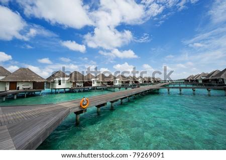 water bungalows in maldives resort #79269091