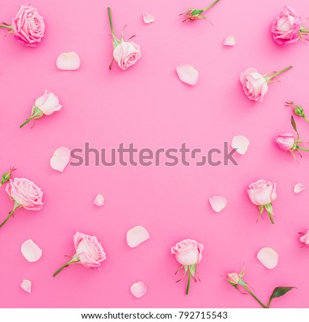 Floral frame with roses flowers and petals on pink background. Flat lay, Top view. Valentines day background #792715543