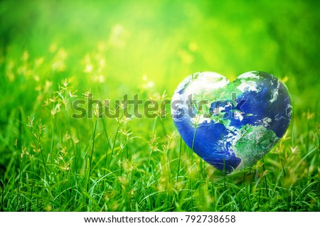 Earth in Heart shape on green grass on sunlight, Love and Save the World for the Next Generation concept, Earth day concept, Elements of this image furnished by NASA Royalty-Free Stock Photo #792738658