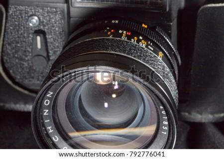 Donetsk, Ukraine: 25 December 2017 - Vintage retro soviet SLR camera Zenit-ET with old Chinon wide lens. #792776041