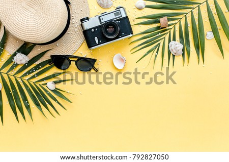 Traveler accessories, tropical palm leaf branches on yellow background with empty space for text. Travel vacation concept. Summer background. Road frame set. Flat lay, top view. #792827050