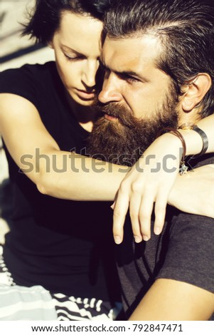 Young couple of beautiful brunette woman and handsome man hipster with beard hug outdoors on sunny day #792847471