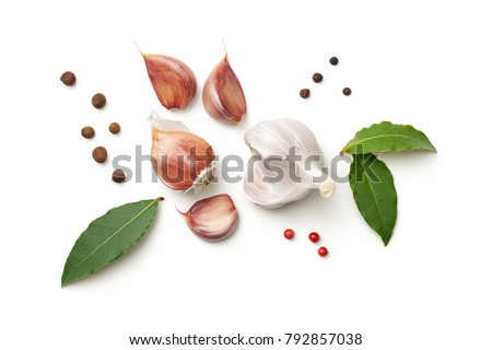 Garlic, bay leaves, allspice and pepper isolated on white background. Top view  #792857038