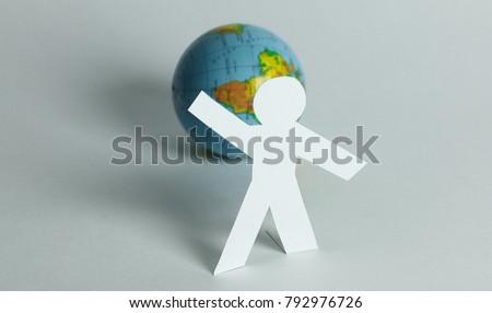 stylish paper man standing near the globe #792976726