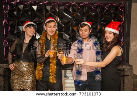 Friends are dancing at a party. New Year, champagne and tinsel #793101073