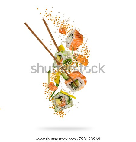 Flying pieces of sushi with wooden chopsticks, separated on white background. Flying food and motion concept. Very high resolution image #793123969