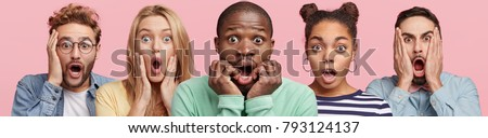 Shocked stupefied dark skinned man and their companions pose against pink background. Emotional surprised horrified mixed race people see something unexpected in front. Human reaction concept #793124137