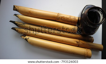 A set of calligraphy reeds with black ink against a white background #793126003
