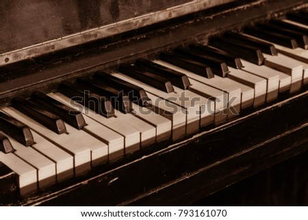 Part of old musical piano keyboard background. Close-up of an old harvest of piano-tree. Broken old broken piano. Musical keys close-up of old musical instrument. Vintage background with music theme