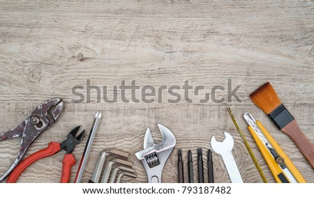 Craftsman tools on grunge wooden background. Assorted work tools set for background. #793187482