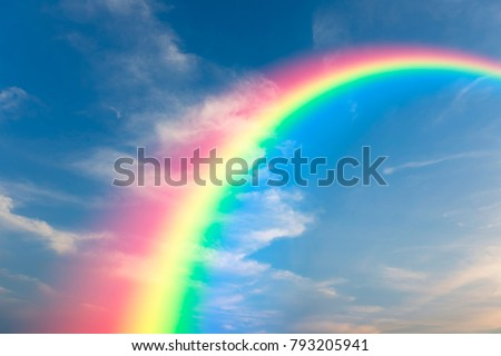 Rainbow and sky background Royalty-Free Stock Photo #793205941