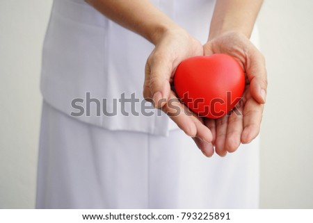 Female nurse hands holding red heart for Health Insurance concept. #793225891