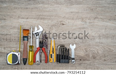 Craftsman tools on grunge wooden background. Assorted work tools set for background. #793254112