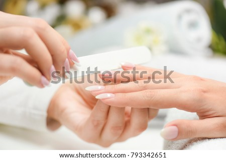 Nails manicure with file. Woman beautiful nail care. after filling. #793342651
