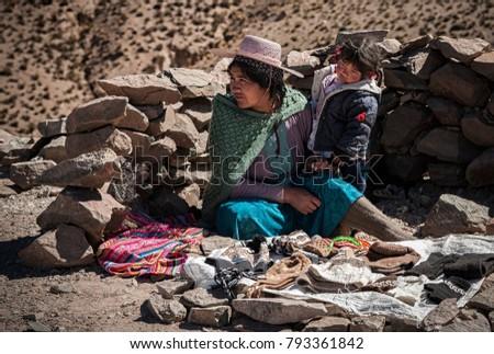 SAN ANTONIO DE LIPEZ - BOLIVIA, AUGUST 10, 2017: Unidentified bolivian people selling craft items on the road to San Antonio de Lipez - Boliva, South America #793361842