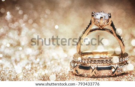 Glitter background with wedding rings #793433776
