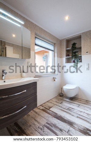 Modern bathroom in vintage style with toilet and vintage floor tiles #793453102