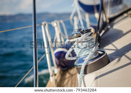 details of sailing equipment on a boat when sailing on the water in a sunny day Royalty-Free Stock Photo #793463284