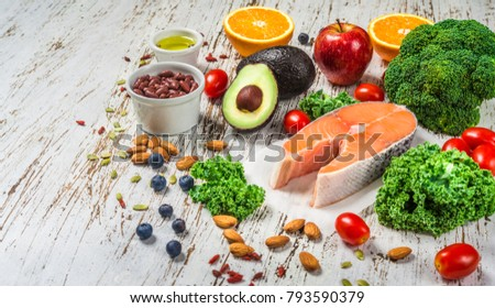 Selection of fresh fruit and vegetables, salmon, grains, and nuts. Concept of cooking and eating healthy food, fitness, dieting, vegetarian, and lifestyle. Ingredients good for heart and diabetes Royalty-Free Stock Photo #793590379