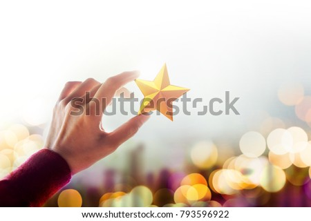Human Resource Management or Talent Concept, Hand holding and Raise up a Golden Star, Blurred Bokeh Light as background #793596922