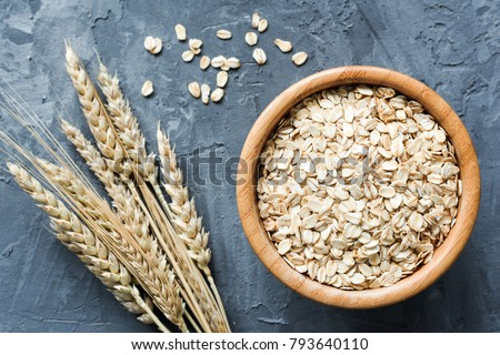 Oats in wooden bowl. Uncooked rolled oats. Oat flakes. Top view. Concept of healthy eating, dieting, healthy lifestyle, weight loss #793640110