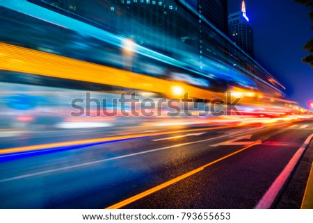 the light trails on the modern building background #793655653