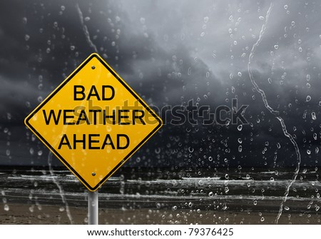 yellow warning sign of bad weather ahead against stormy sky #79376425