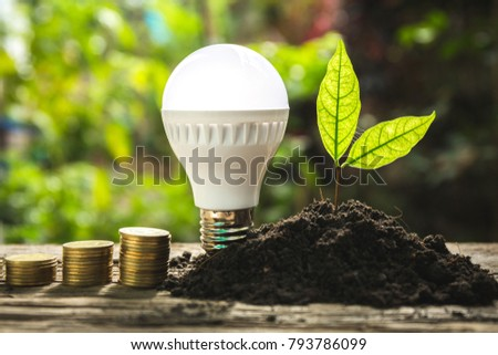 Saving energy concept with lightbulb and coin. #793786099
