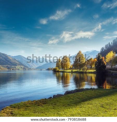 Impressively beautiful Fairy-tale mountain lake in Austrian Alps. Breathtaking Scene. Panoramic view of beautiful mountain landscape in Alps with Zeller Lake in Zell am See, Salzburger Land, Austria #793818688