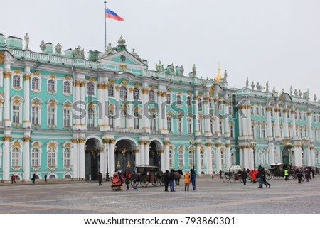 Winter Palace (Hermitage Museum) View from Palace Main City Square in Saint-Petersburg, Russia. Historical Royal Family Palace Built for Emperor Peter the Great on Winter Time with Tourists Around.