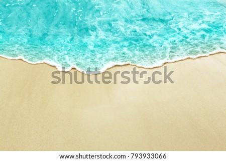 Ocean or sea wave on the sunny yellow beach sand #793933066