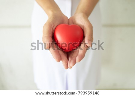 Woman take care a red heart to healthy by hospital. #793959148