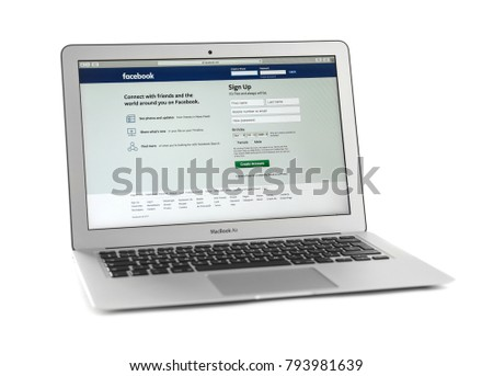 KIEV, UKRAINE - OCTOBER 13, 2017: Apple silver MacBook Air displaying open Facebook page on white background #793981639