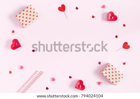Valentine's Day. Frame made of gifts, candles, confetti on pink background. Valentines day background. Flat lay, top view, copy space. #794024104