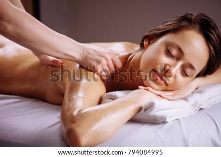 Body care. Spa body massage treatment. Woman having massage in the spa salon #794084995