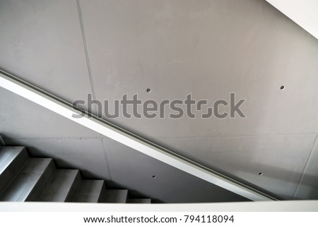 Modern stairwell with concret-look walls #794118094
