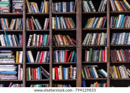 Blurred image of colorful books in shelves