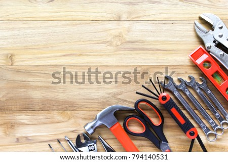 Working tools on the wooden background with space for text. #794140531