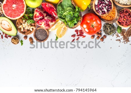 Superfoods on white background. Organic food and healthy vegan food. Legumes,  nuts, seeds, greens, oil and vegetables. Top view with copy space. #794145964