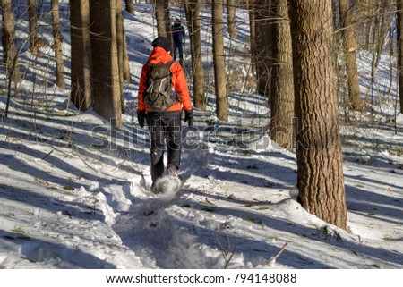 Medford, USA - January 7 2018: Woman snowshoeing in the Middlesex Fells. #794148088