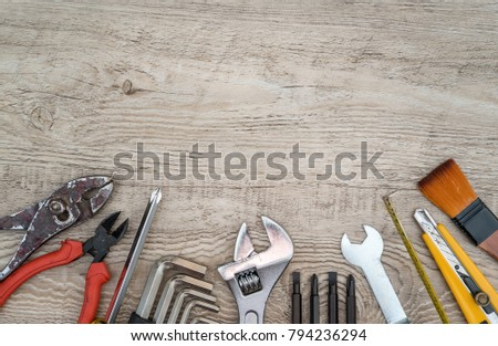Craftsman tools on grunge wooden background. Assorted work tools set for background. #794236294