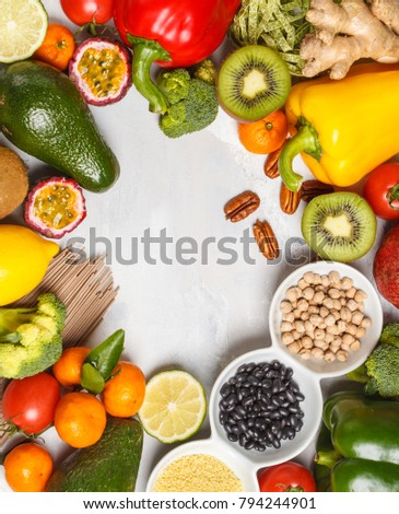 Healthy vegan food concept. Fruits vegetables background. Fresh vegetables, exotic and seasonal fruits, cereals, pasta, nuts and beans for a vegetarian diet. Copy space, light background. #794244901