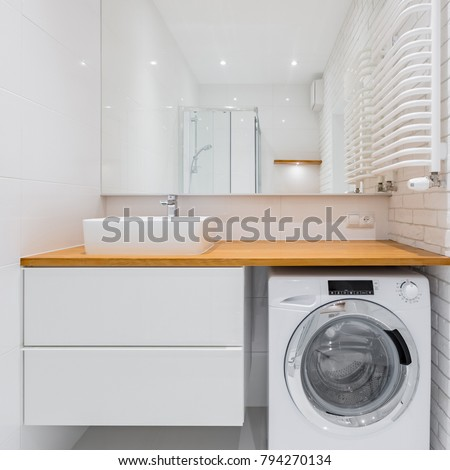 White bathroom with countertop basin, big mirror and washer #794270134