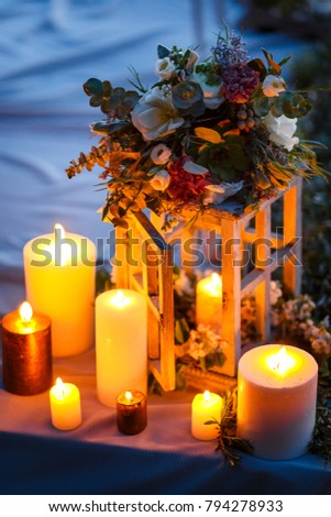 Wedding decor, candles in wooden flasks in the forest #794278933