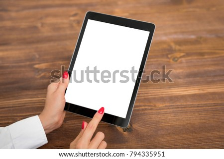 Person using tablet with empty blank screen, vertical orientation