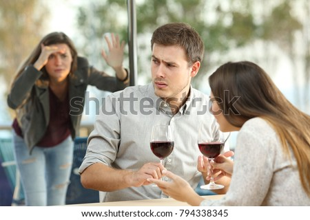 Obsessed ex girlfriend spying on an annoyed couple dating in a restaurant #794338345