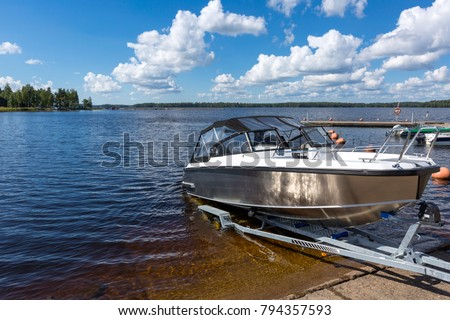Boat launch on lake water #794357593