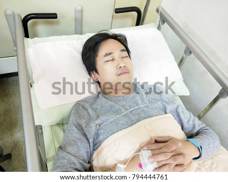 patient man lying on the hospital bed  #794444761