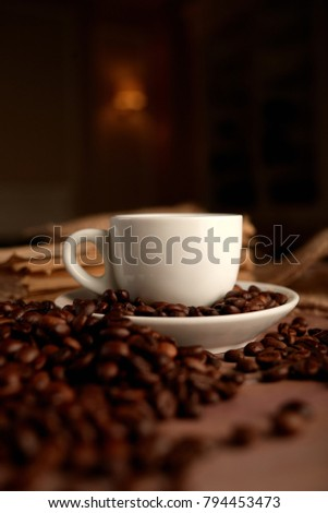 Coffee cup and saucer on a wooden table. Dark background. #794453473